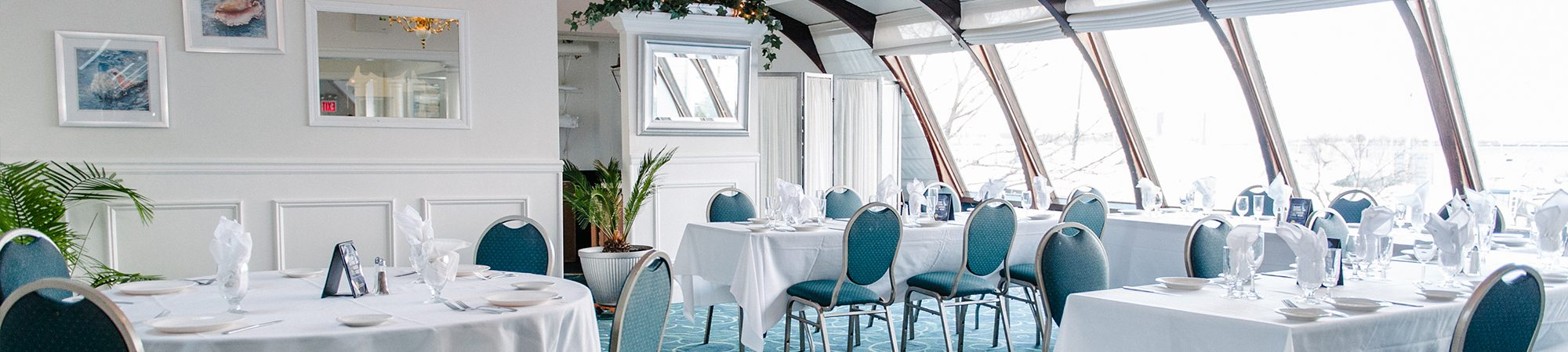 A white and blue themed dining room